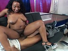 This busty ebony dances around the stripping pole for an invalid man. Then, she sucks his big black cock and rides him after he moves on the couch from the wheelchair.
