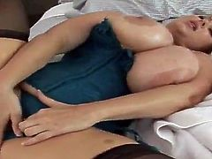 Salacious mature blonde Samantha 38G is having fun with some guy indoors. She oils her enormous tits and demonstrates them to the man and then gets her coochie pounded from behind.