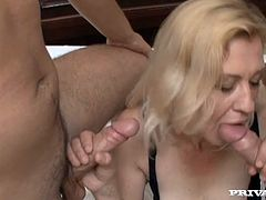 Big bottomed blonde in stockings blows dick and gets her slit fucked doggy style