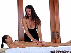 Sexy masseuse babe giving her client a sensual lesbian massage