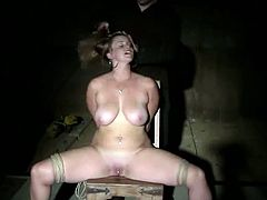 Big-breasted slut Bella Rossi strips and gets bound by some dude in a cellar. The man plays with Bella's awesome natural tits and then makes her cum with the help of a dildo.