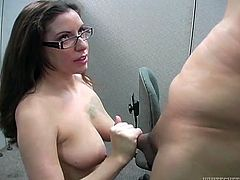 Naughty brunette in glasses gives her boyfriend playful blowjob. She stands on her knees and swallows his pole and tickles his balls and penis stem with her playful tongue.