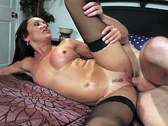 Attractive tanned black haired Michelle Lay with delicious juicy ass in stockings only rides like crazy on young dude Dane Cross and sucks his cock like there is no tomorrow.