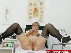 Natural big tits mature milf undresses her nurse uniform to show her big naturals, then she starts to spread her mature vagina with gyno pussy spreader