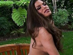 Madelyn Marie with big hooters and clean bush does striptease before masturbating with passion