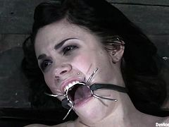 Kinky brunette girl lies on the floor being tied up. She gets her pussy toyed deep and hard. After that she also gets whipped and tortured with claws.