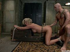 Blonde chick in stockings stands on her knees sucking big dick. After that she gets fucked hard in both holes by Derrick Pierce.