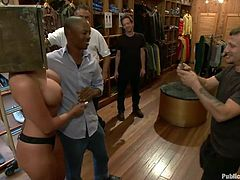 This sexy blonde milf is being humiliated, by a group of men. She has a safe on her head, so she can't see, and she is paraded around. One man puts nipple clamps on her tits and it hurts her badly. She sits back on a stool and one of her masters, fingers her, in front of the group.