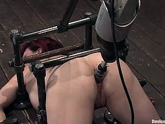 Tattooed redhead girl lies on the floor being bounded. She gets her her ass toyed deep and hard by ruthless fucking machine.