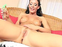 Angelic hoochie Lora Craft has fire in her eyes as she fingers her honeypot