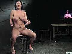Busty brunette mom Claire Dames is having fun in BDSM clip. She gets chained and hang up and loves being pulled by the nipples.