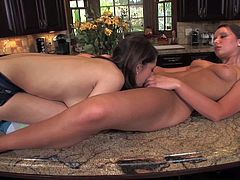Lexi Bloom and Sally Charles are sweet brunettes that cant keep their fingers and tongues off each others pussies. They really enjoy pussy licking in the kitchen. Watch sweet dykes do it.