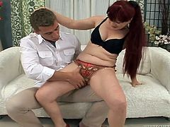 Lustful redhead chick strips her dress off. She sucks a dick and plays with her hairy pussy at the same time. Later on she gets fucked in doggystyle and sideways positions.