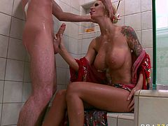 Buxom porn star Brooke Banner gives stout blowjob in the shower tub. She then takes hard dong in her wet slick pussy from behind.