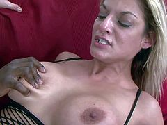 Blonde whore Klarisa Leone with big fake tits in fishnet lingerie and stockings gets two rock hard cocks up juicy ass at once in threesome with Steve Q and his black friend.
