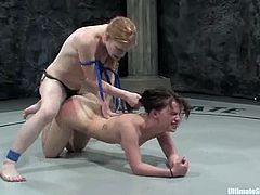 Devi Lynne and Madison Young are having a vigorous scuffle on tatami. The girls fight with each other, then Madison wins and pounds Devi's tight coochie with a strapon.