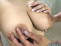 Watch a vicious and busty Japanese brunette as she gets her big tits licked by a naughty dude in the shower during this wild video. Those boobs are amazing!