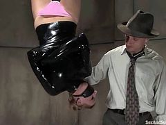 Stunning blonde girl gets tied up to a chair and fingered by an investigator. Later on he puts her on a table and fucks her hot pussy.