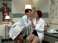 Two sexy redhead chicks take their hospital gowns and clothes off. Later on Phoenix Askani gets tied up with straps and toyed rough by her colleague.