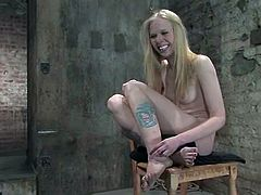 Claire Adams is having BDSM fun with Sarah Jane Ceylon in a basement. The submissive blonde gets bound and hung up and then enjoys being humiliated and hurt.