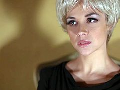 Attractive short haired blonde bombshell with jaw dropping tits and awesome seductive skills in black bra and stockings teases Ryan McLane and makes him eat her pussy like Lessie.