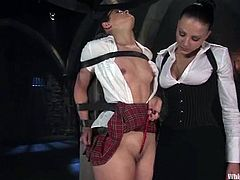 Nikki Nievez and Penny Barber are having BDSM fun in a basement. The college girl gets tied up and tortured and then enjoys it when the dominatrix pleases her with fingering and toying.