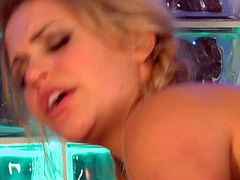 Charming blonde with pigtails keeps her legs wide open and rolls her eyes under the waves of pleasure while her sex partner polishes pussy.