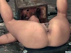 Stunning brunette girl gets bonded in rough BDSM video. Then she gets her ass and pussy drilled with a fucking machine.