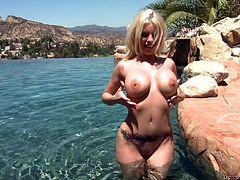 Britney Amber is having fun with Domenic Kane indoors. She drives him crazy with a terrific blowjob and a great titjob and then they have sex in cowgirl and other positions.