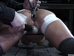 This busty babe Trina Michaels is so fucking hungry for pain. Her master takes her out of the cage and then traps her in the iron net, tighter and tighter.