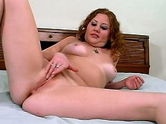 If you love to watch some amateur chick doing solo pussy wanking on the bed, than click and watch this redhead broad doing it with the style