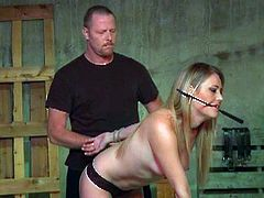 Wasteland dungeon master ties up her submissive blonde babe with nasty attitude to teach her some manners.Watch how he whips her and spanks her tight ass in this hot video.