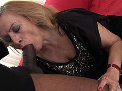 This mature, older white woman goes interracial and decides to suck and fuck a big black man. He gives her a cumshot all over her stomach.