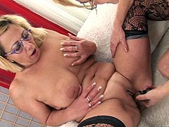 Lustful old lesbians Milli and Beata A are having some good time together. They kiss and fondle each other's bodies and then demonstrate their fingering and toying skills.