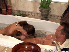 Katie likes showering with her guy. She soaps him up in the shower and makes the man horny. After she plaid with him they go in the bath tub where the taunting is over. Katie goes don to more serious things and grabs his penis like a whore. She sucks him hard in the tub, making the guy want to cum in her.