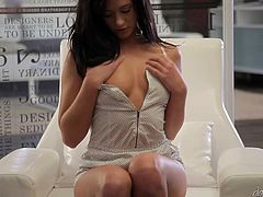 Engaging brunette Tess Lyndon is getting naughty in her room. She strokes her perfect body passionately and then enjoys fingering her smooth pussy.