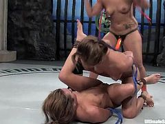 Two girls fight in a ring and then fuck. Gwen Diamond gets toyed hard. After that another girls joins them. So, Gwen gets toyed by Isis and DragonLily in both holes at the same time.