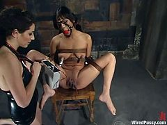 Nasty brunette Nadia Styles is getting her punishment in a basement. She gets bound and tortured and then gets her snatch toyed to orgasm.