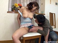 Sizzling Japanese chick Aya Takekawa spreads her legs wide and allows her man to rub her juicy vag with a dildo. The guy licks and kisses Aya's tits and makes everything to make her cum.