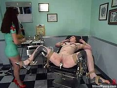 Electrical devices are used in this lesbian BDSM session by the naughty nurse who knows how to get kinky with her patients.