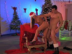 Long haired tempting blonde Holly Taylor with perfectly shaped firm hooters and long sexy nails in Christmas uniform gets pounded from behind by handsome Billy Glide with rock hard cock.