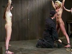 Two amazing and sexy babes Christina Carter and Winter Sky are in a painsult and under sadism. Huns gets suspended on the bars and their masters twitch their bellies!
