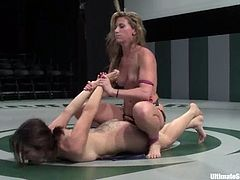 Karrlie Dawn loses a fight to Ariel X. So, she sucks a strap-on like it is a real dick and then gets toyed rough from behind. Ariel also shoves thong in Karrlie's mouth.