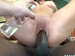 Watch this sexy brunette puckering her lips together as this guy cums all over her face after she's fucked by his black monster cock.