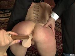 Two tied up chicks with clothespins fixed to their tits toy each others pussies with strap on. Surely their master is satisfied with this show.