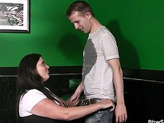 Rebecca wears her slutty schoolgirl skirt but her ass is far to big for it. She barely bends over to hit the ball on the snooker table and her booty is visible. This skinny young dude sees her sexy ass and gets turned on by it. Luckily, Rebecca is a fucking whore so she kneels and sucks him hard.