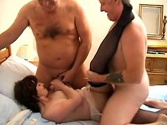 Double penetration is not something new for this horny mature lady! She is loving that thick cock so bad, while sucking one of them.