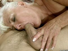 Rapacious blonde mommy with big saggy tits provides her young lover with steamy blowjob. Then mature babe lies on her back letting that guy lick her wet trimmed pussy.