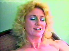 Click on this vintage video and watch this horny blonde mature being eaten out and fucked by this guy.