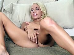 Devon Alexis with big knockers and smooth twat touches her muff playfully